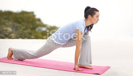 Full length shot of a young woman doing yoga outdoorshttp://195.154.178.81/DATA/i_collage/pi/shoots/805667.jpg