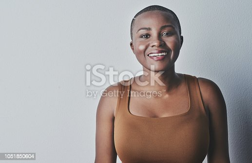 Studio shot of beautiful young women posing against a grey background