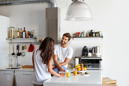 Shot of a young couple having a relaxing breakfast together at home