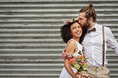 Shot of a newly married young couple celebrating their wedding day against an urban background