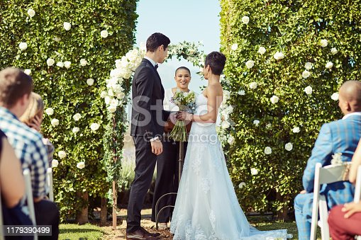 Shot of a happy young couple getting married in a garden