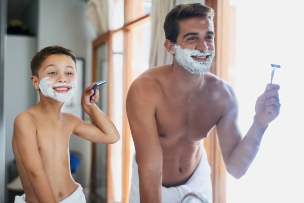 Shaving Boy Stock Photos, Pictures & Royalty-Free Images