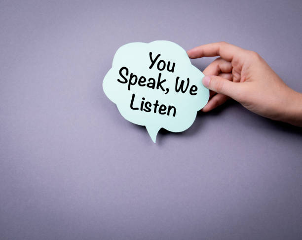 You speak, we listen You speak, we listen. Speech bubble on a gray background listening stock pictures, royalty-free photos & images