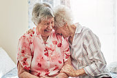 Shot of two happy elderly women spending time with each other at home