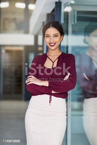 Portrait of a confident young businesswoman working in a modern office