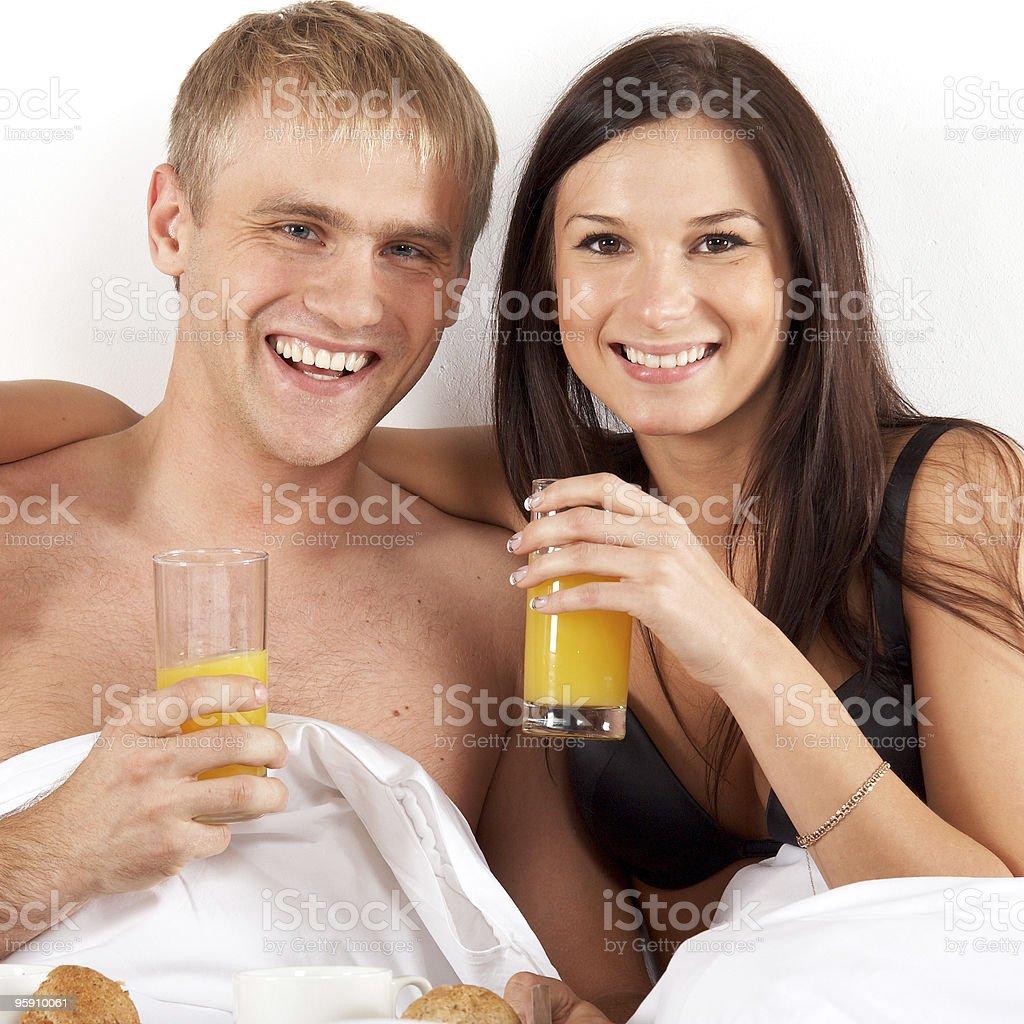 Youg couple drinking juice royalty-free stock photo