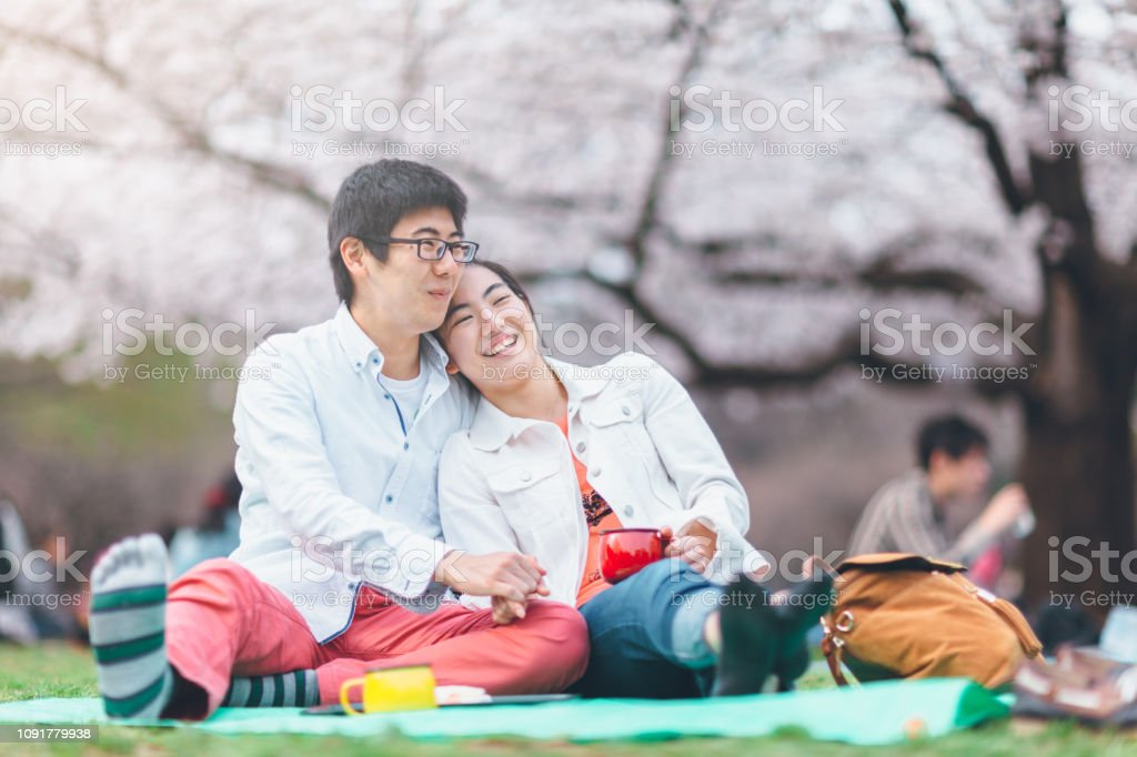 Youg Couple Having Picnic In Spring Stock Photo Download Image Now Istock The young, an american rock band. https www istockphoto com photo youg couple having picnic in spring gm1091779938 292914284