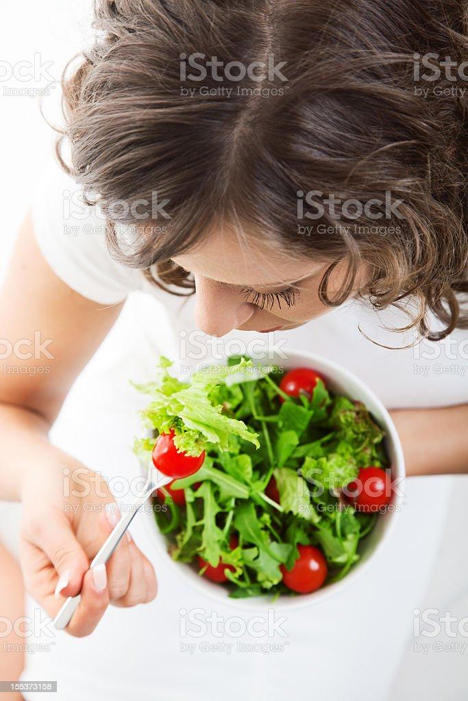 Youg woman eating healthy salad royalty-free stock photo