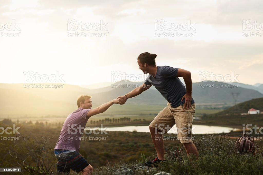 You'll aways find a helping hand on the trail stock photo
