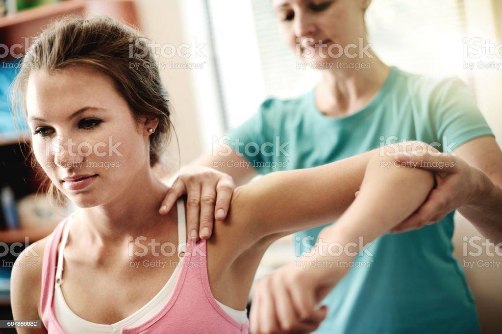 Sie werden wieder in das Spiel in kürzester Zeit - Lizenzfrei Allgemeinarztpraxis Stock-Foto