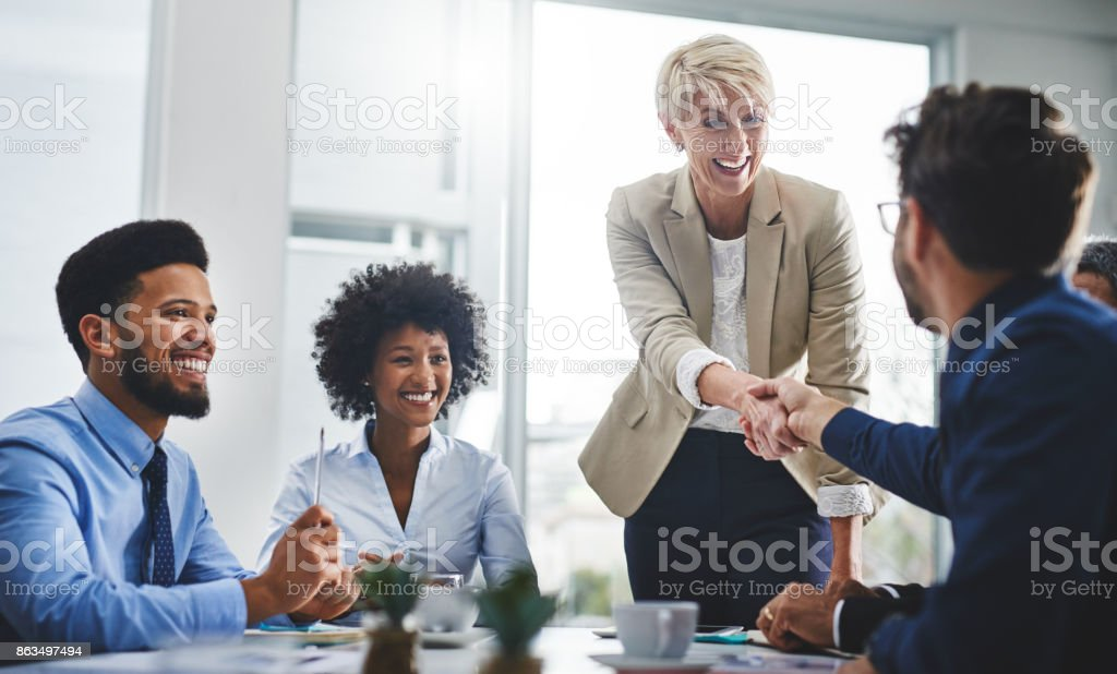 You'll love the togetherness of our team stock photo