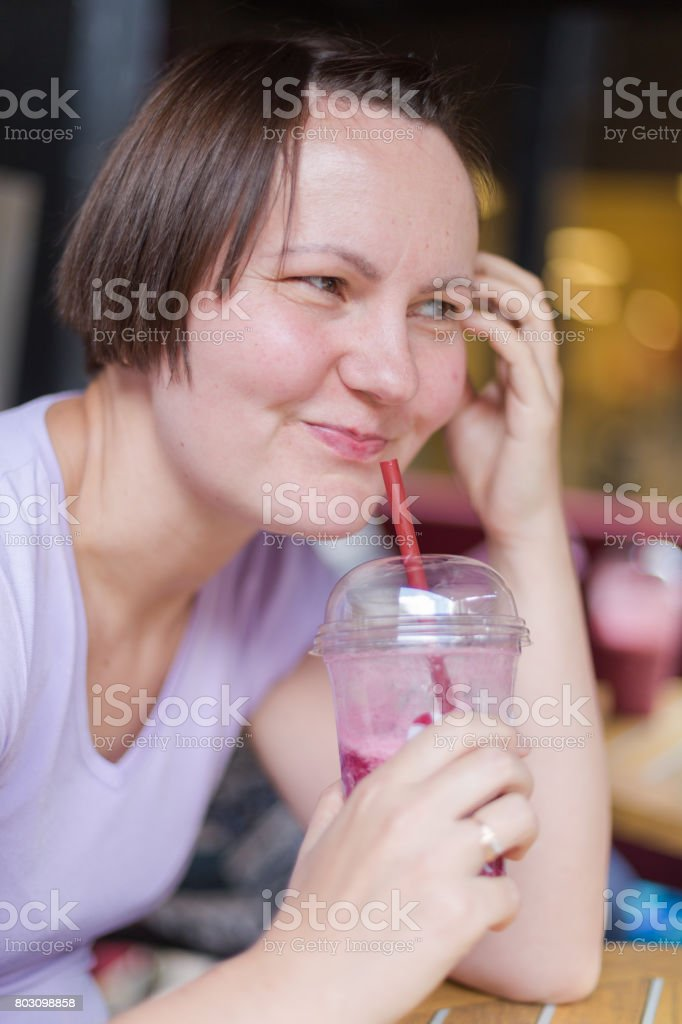 Youn adult woman spends free time with friend in coffee shop stock photo