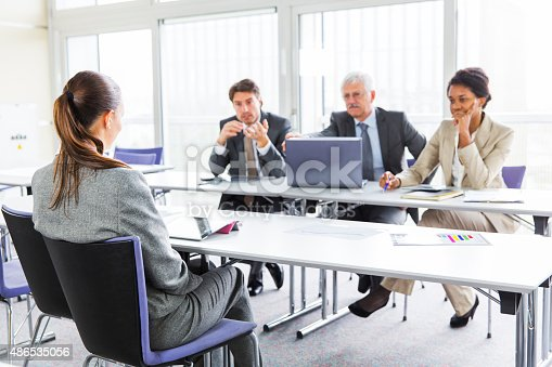 Youn woman is trying to get her a job,sitting infront of board of examiners...interview
