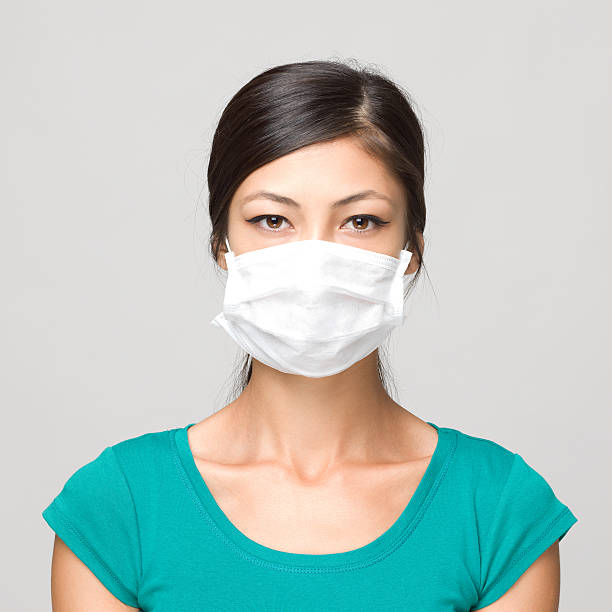 Best Flu Mask Stock Photos, Pictures & Royalty-Free Images