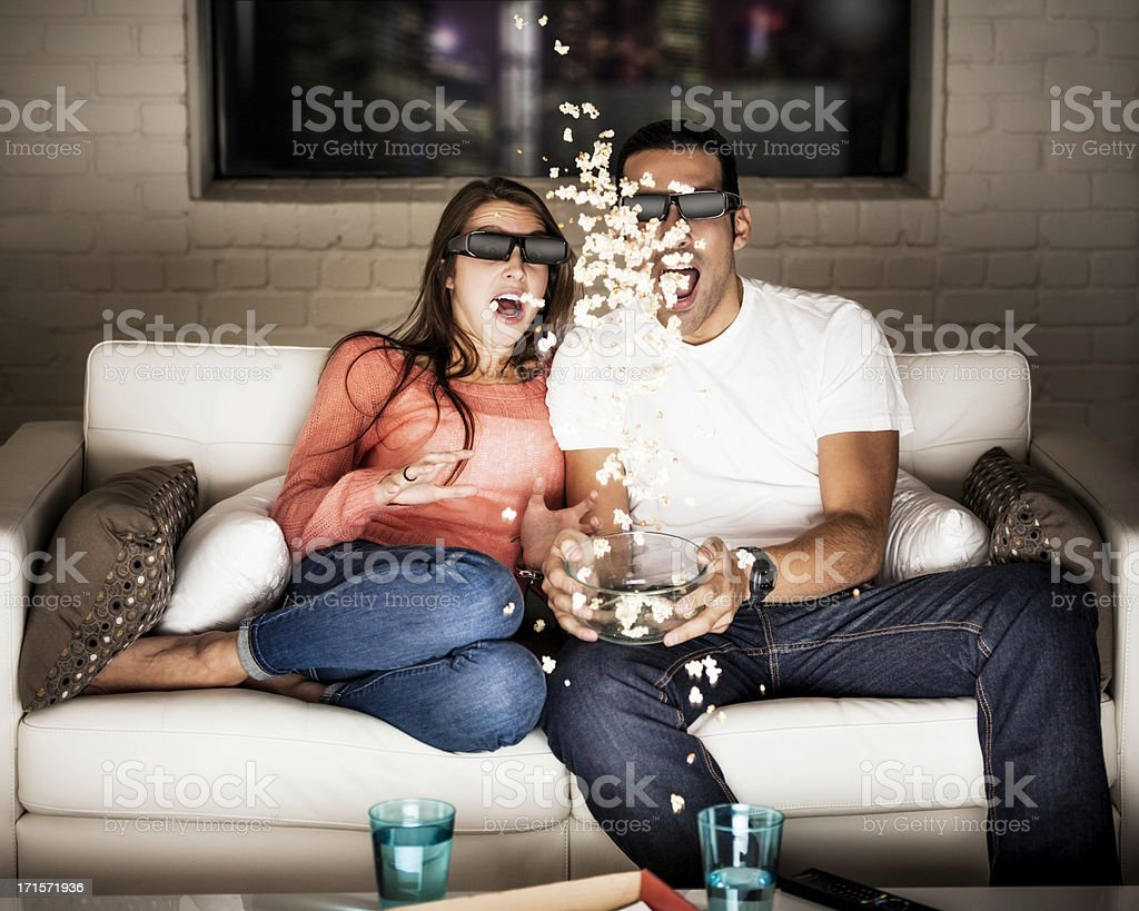Yound Adults Watching a 3D Movie royalty-free stock photo