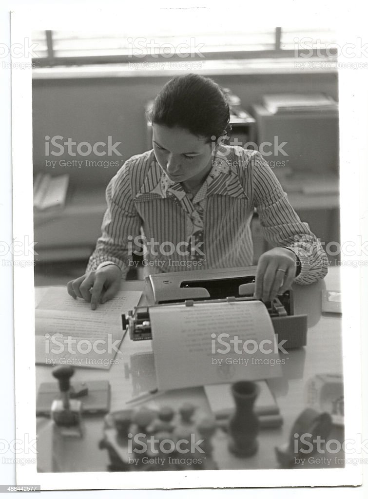 Young 1970s woman working royalty-free stock photo