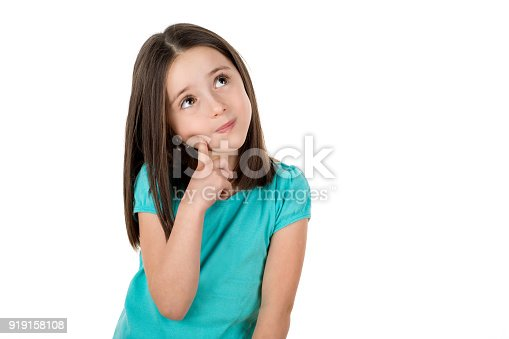 istock Young 6 years old girl looking up thinking searching for ideas or debating. 919158108