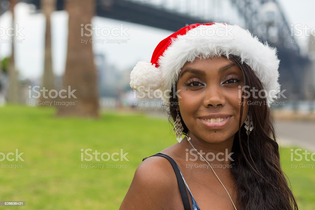 Young Aboriginal Woman in Santa Hat stock photo