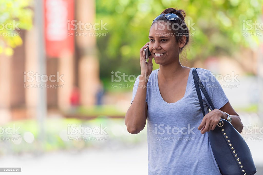 Young Aboriginal woman on the phone stock photo