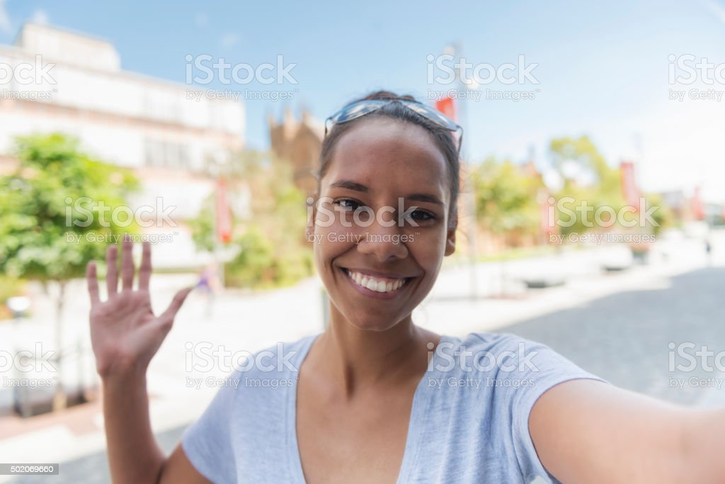 Young Aboriginal woman taking a selfie stock photo
