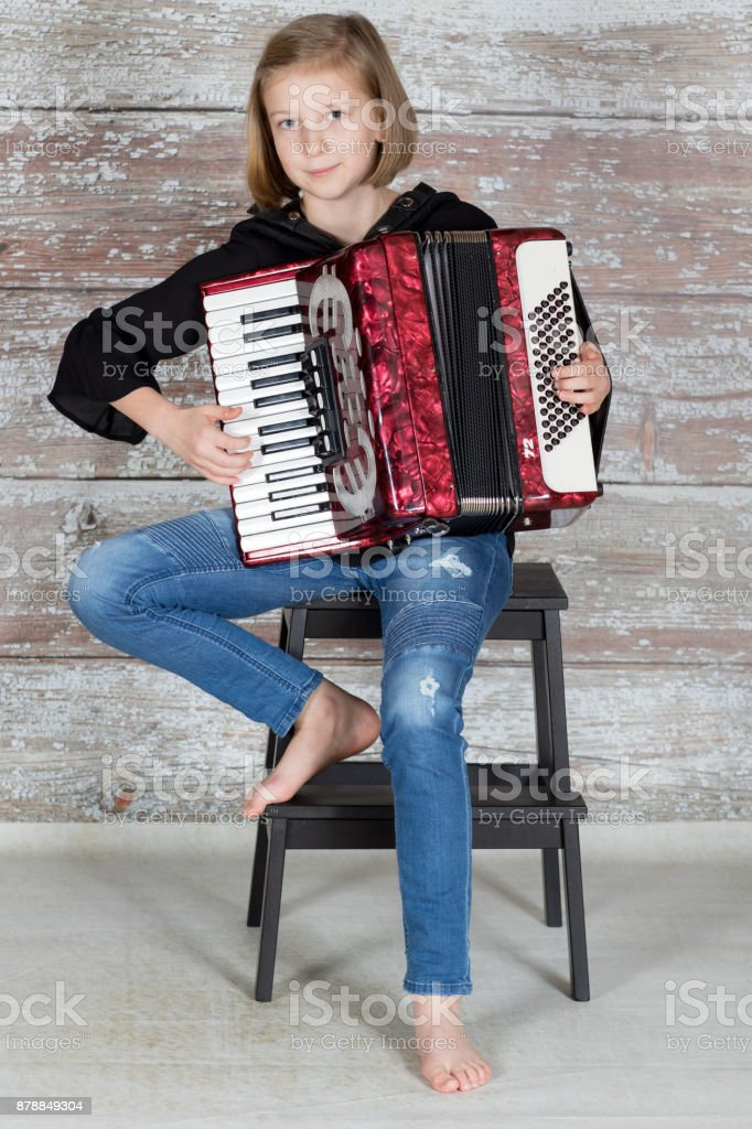 Young Accordionist Playing An Accordion Stock Photo