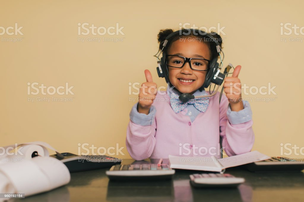Young Accountant Girl Doing Taxes at Desk stock photo