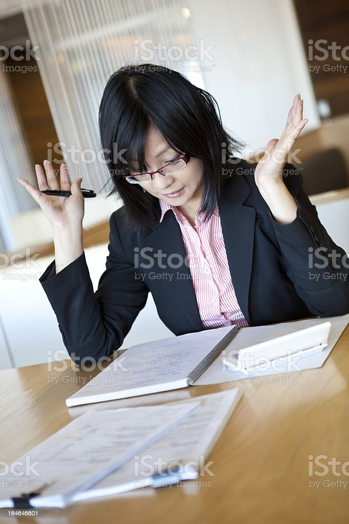 Young accountant is stressed at work royalty-free stock photo