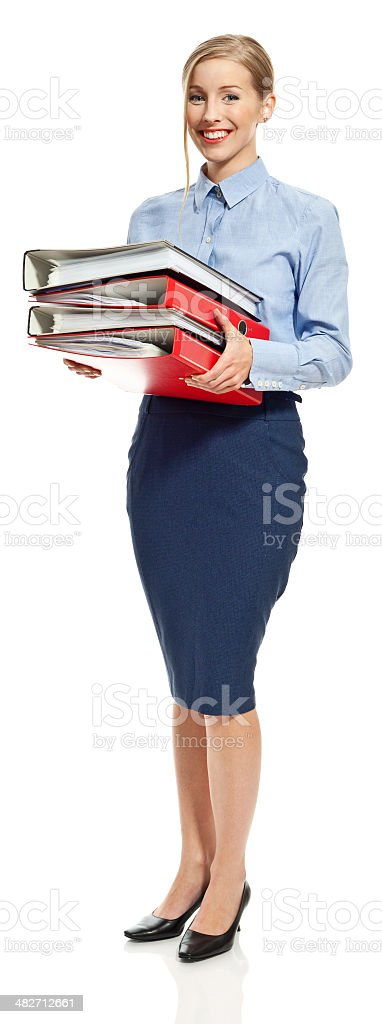 Young accountant Full lenght portrait of young accountant standing with office folders and smiling at camera. Studio shot, white background. 20-29 Years Stock Photo