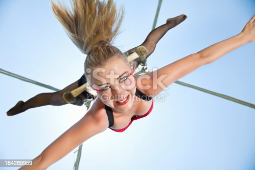 istock Young Acrobat Hanging Upside Down With Arms Out 184289959