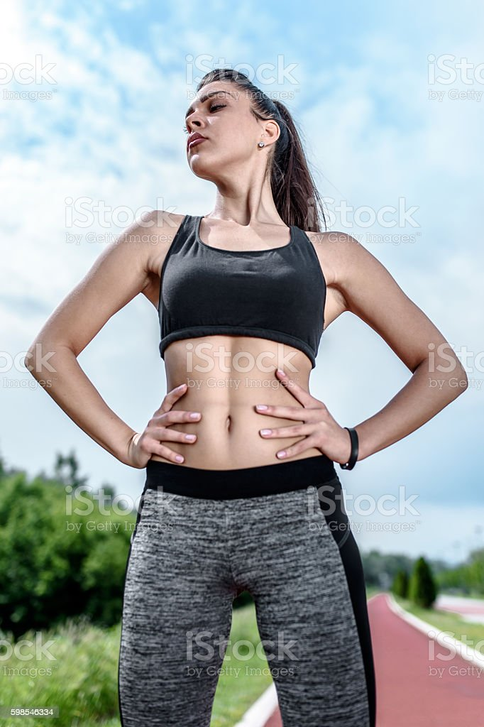 Young Active Girl Standing on the Racing Track photo libre de droits