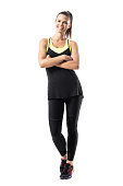 istock Young active healthy fit woman in sportswear smiling at camera with crossed hands. 825302252