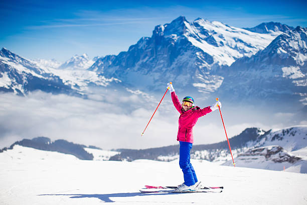 young active woman skiing in the mountains. - ski stock-fotos und bilder