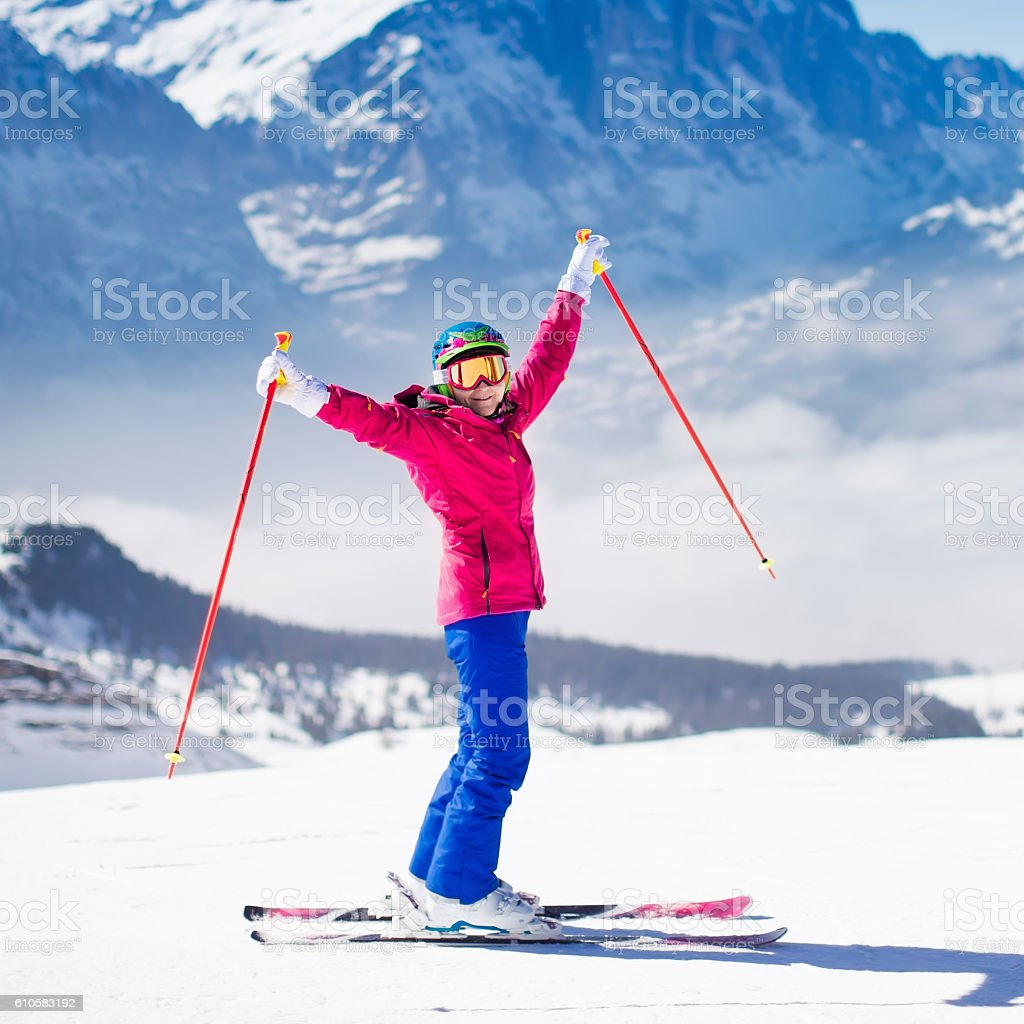 Young active woman skiing in the mountains. stock photo