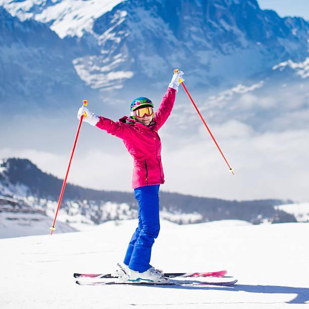 young active woman skiing in the mountains. - winter austria train bildbanksfoton och bilder