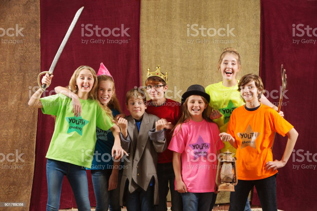 Young actors pose with costume pieces stock photo