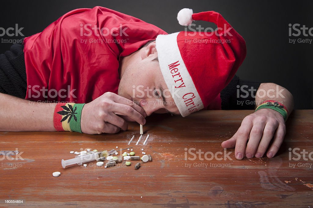 Young addicted guy dressed in Christmas clothes royalty-free stock photo