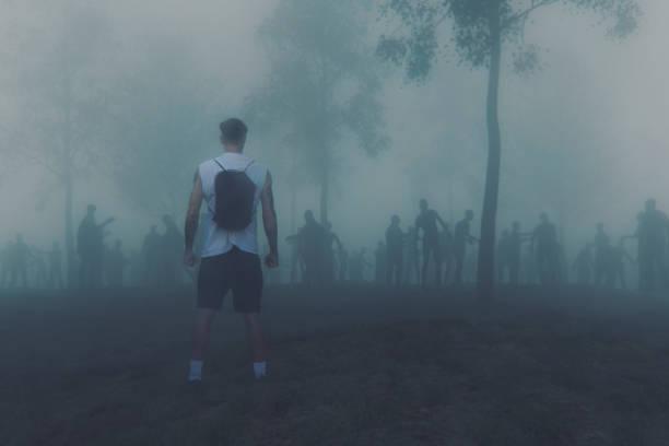 junger erwachsener gegen zombie-horden - plants of zombies stock-fotos und bilder