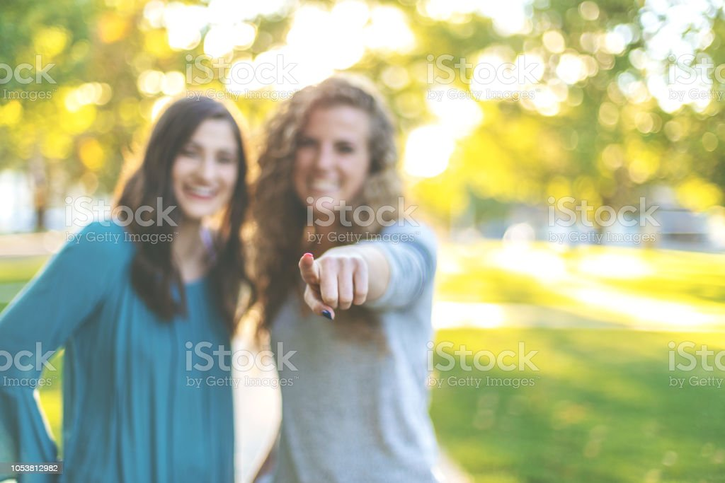 Young Adult Attractive Female College Students Early Autumn Fun in a Public Park stock photo