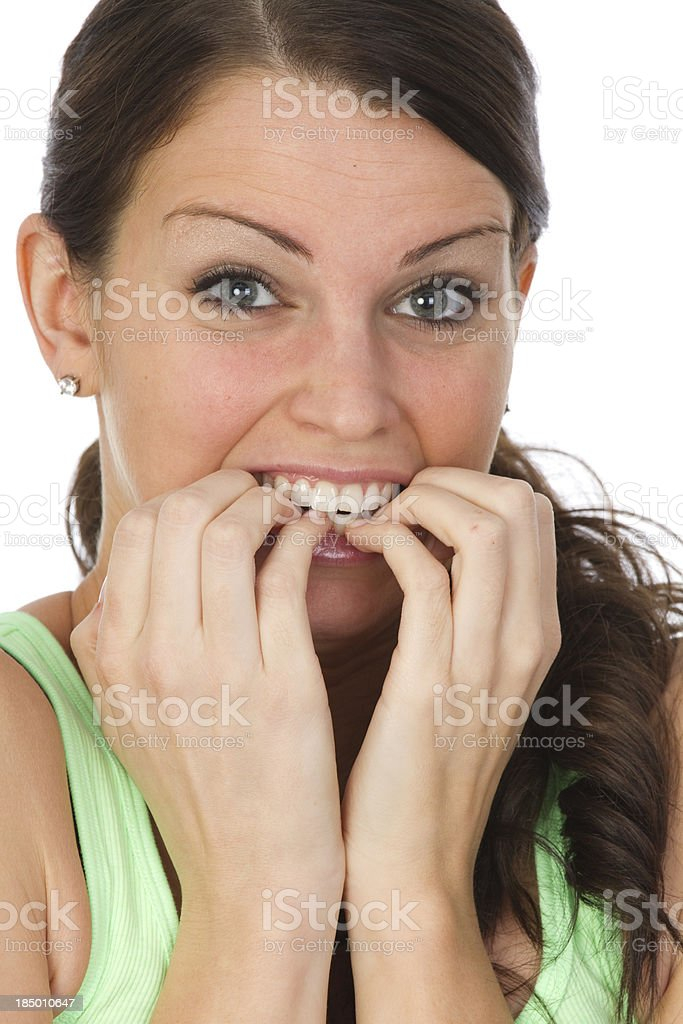 young adult biting her nails royalty-free stock photo