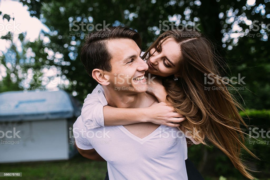 Young adult brunette man and woman in the park stock photo