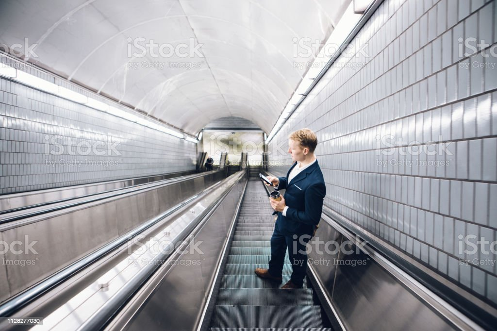 young adult businessman commuting to work stock photo