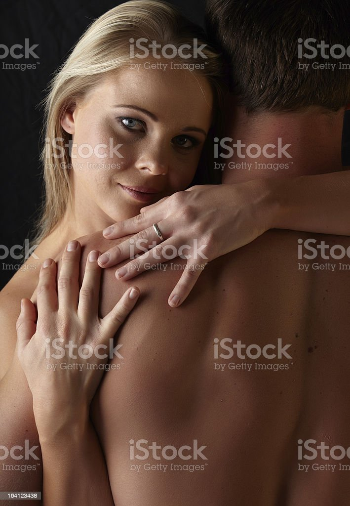 Young adult caucasian couple in nude embrace. royalty-free stock photo
