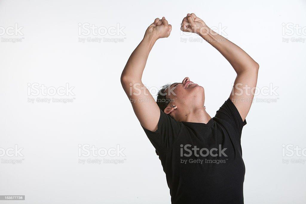 Young Adult Celebrates on White Background stock photo