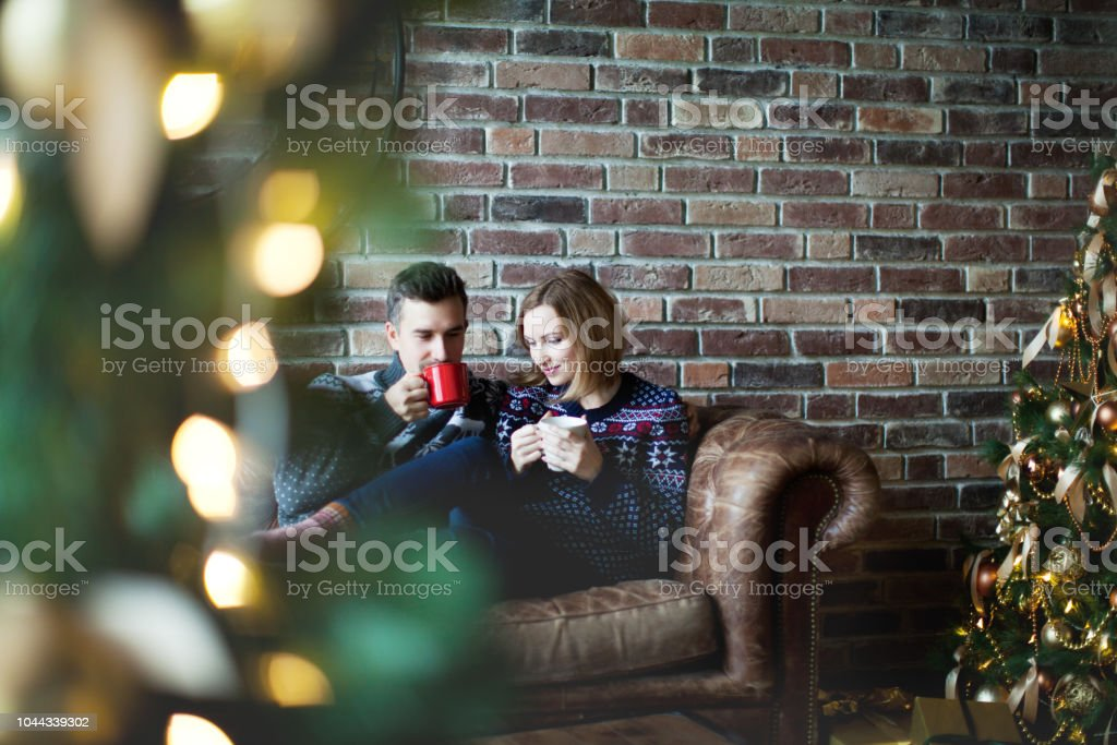 Young adult couple at home on Christmas vacation