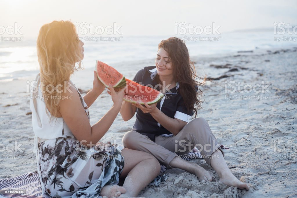 Lesbians eating out beach