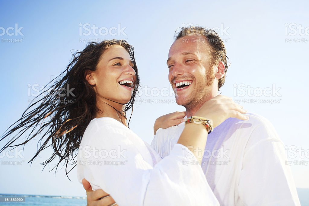 Young adult couple expressing emotions and hugging. royalty-free stock photo