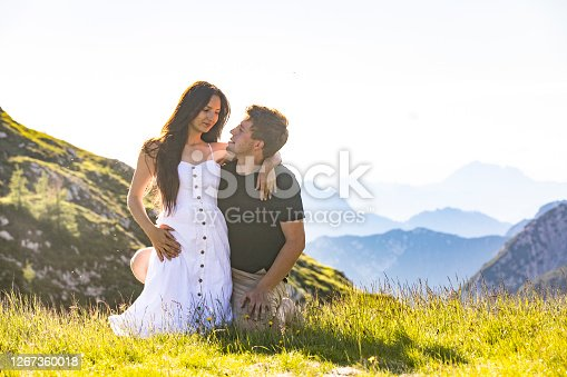 Young Adult Couple Hugging and Relaxing on Weekend Escape in the Hills.