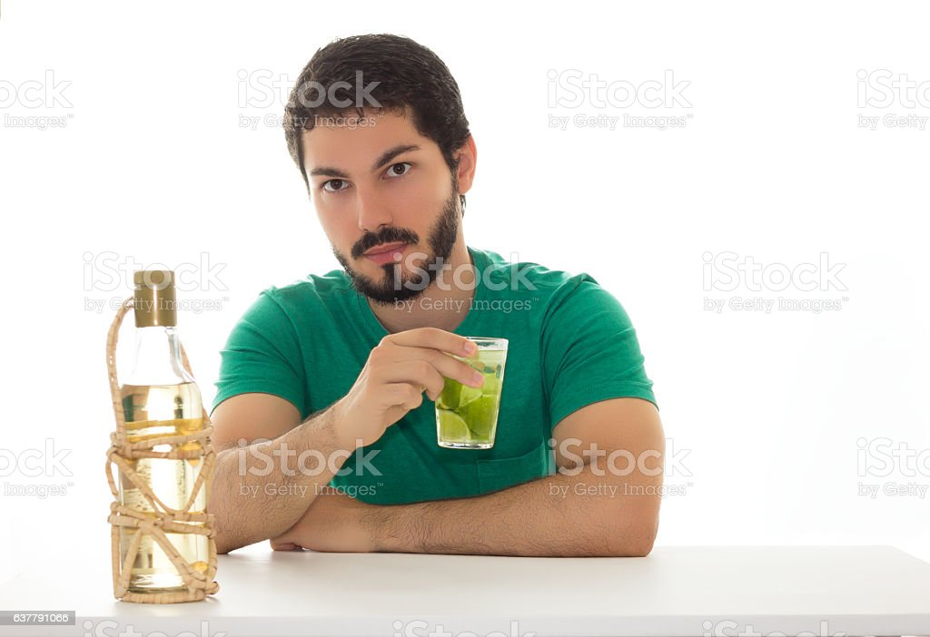 Young adult drinking a cocktail with lemon. stock photo