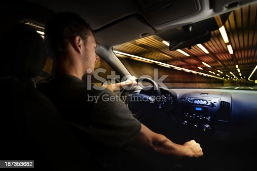 Young Adult Driving Over the Speed Limit in a Tunnel. View from inside the car.