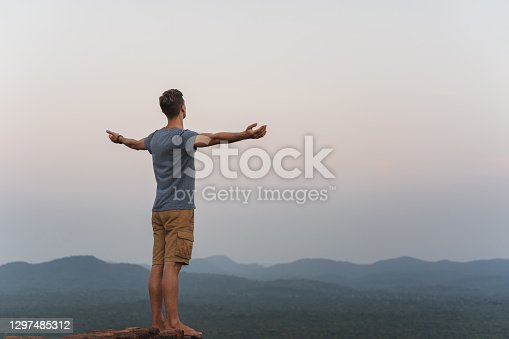 istock young adult feel free from lion rock in Sri Lanka 1297485312
